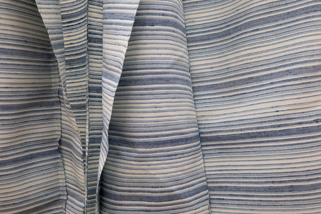 Close up of Kimono with horizontal blue and white lines going across the fabric.
