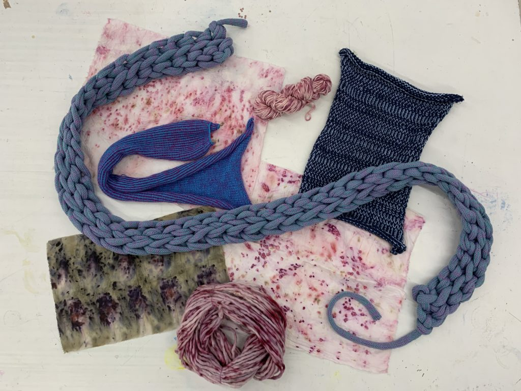 Scraps of different textiles of Anthony's; pieces of yarn and knitwear as well as rectangular scraps of dyed fabric