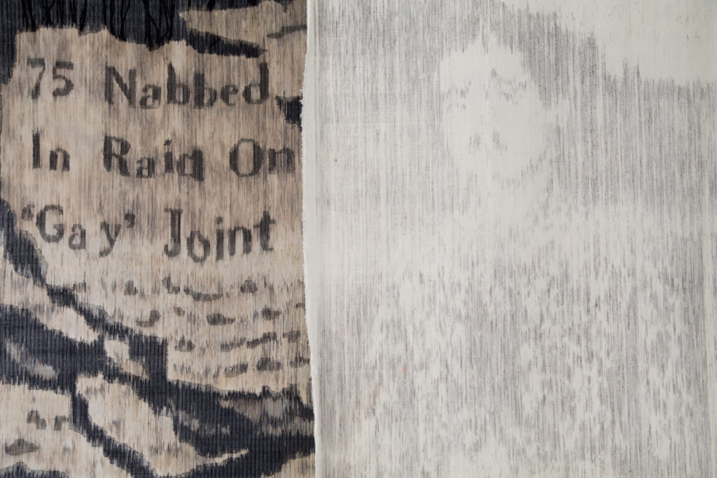 Two tapestries, the left with a headline '75 Nabbed In Raid on Gay Joint' and right with image of a man who was arrested